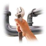 Pipes with a hand holding a wrench in the foreground