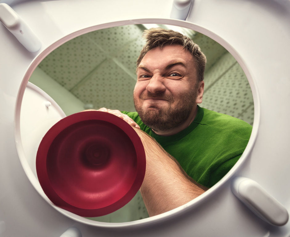 A man coming toward a toilet with a plunger from the toilet's point of view
