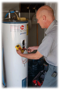 Service man working on a water heater