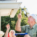 Senior couple doing home maintenance